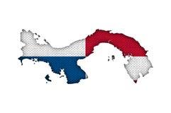 Kartlägga och flaggan av Panama på gammal linne Arkivbild