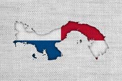 Kartlägga och flaggan av Panama på gammal linne Royaltyfri Bild