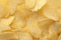 Kartoffelchiphintergrund Stockbild