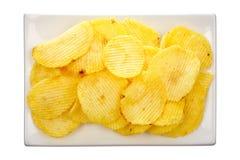 Kartoffelchips auf einer Platte Lizenzfreie Stockfotografie