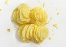 Kartoffelchips getrennt auf weißem Hintergrund Lizenzfreie Stockbilder