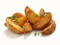 Kartoffelkeile Stockfoto