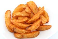 Kartoffelkeile Stockbild