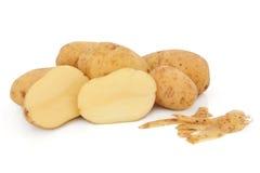 Kartoffeln und Schalen Stockfotos