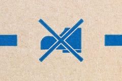 kartonowa tekstura z butami zakazującymi znaki Obrazy Stock