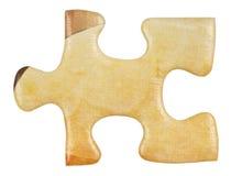 Kartonowy żółty kawałek wyrzynarki łamigłówki zakończenie up Obraz Royalty Free