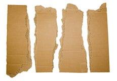 Kartonstroken met hoeken worden gescheurd die stock afbeeldingen