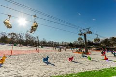 Karuizawa, JAPAN - June 8, 2018:People to play ski ,snowboard and cable car at ski resort in winter on holiday of Nagano. Prefecture, Japan stock image