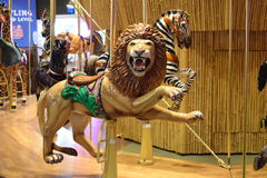 Karusell med den Lion Seat On karusellen Arkivbild