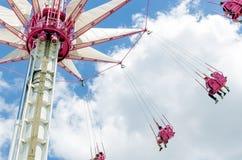 Karusell med flygfolk på rosa platser Fotografering för Bildbyråer