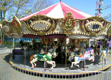 karusellen går den glada rounden Royaltyfri Bild