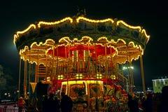 Karusellen i det nya året semestrar i Chernihiv Royaltyfria Foton