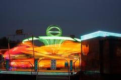 Karuseller på natten arkivbilder