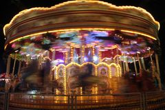 Karusellflyttning på natten Fotografering för Bildbyråer