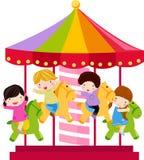 Karusellhäst och barn Royaltyfri Foto