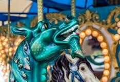 Karusellhäst och drake Arkivbild