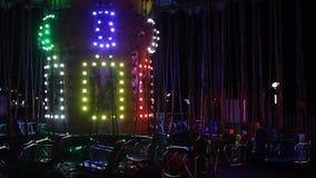 Karussell mit dem farbigen Lichtblitzen stock video footage