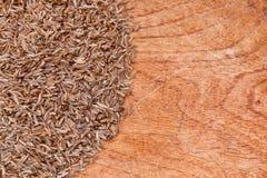 Karwij op hout Stock Afbeeldingen