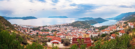 Kas town, Turkey. Panorama view of Kas town in Antalya province of Turkey, with small town port and island Meis in distant horizont Royalty Free Stock Images