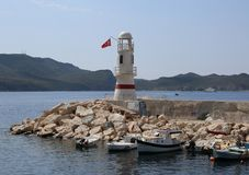 Kas Lighthouse and Fishing Boats at Kas port stock photos