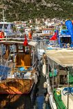 Kas, Turkey, 05/16/2019: Marina with fishing boats and yachts in a sunny resort town. Vertical royalty free stock photography