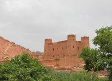 Kasbah. A Kasbah between the green trees in Gorge du Dades, Morocco Royalty Free Stock Image