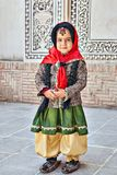 Iranian girl in Tabatabaei historical house, Kashan, Iran. Kashan, Iran - April 26, 2017: Iranian girl in multicolored traditional clothes stands in Tabatabaei Royalty Free Stock Photos