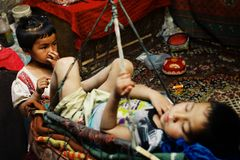 cute young uyghur kids resting at home stock image