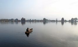 Kashmir boat man selling on Dal Lake stock photography