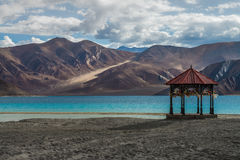 Kashmir Pavilion with pray flag stand alone at Pangong lake with beauty view. Stock Photography