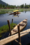 Kashmir taxi. Water taxi in Kashmir, India taking passengers to their houseboat stock photography