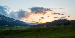 Kashmir valley, sunset panorama HDR. Sunset in Gulmarg or Kashmir valley HDR with glowing sunset and clouds and a dark valley slowly getting darker as evening stock image
