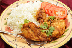 Kashmiri chicken with rice tomato and fork Stock Photos