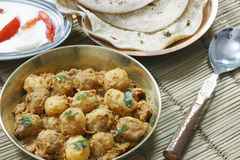 Kashmiri dum aloo is a deep fried baby potatoes cooked in yogurt. Kashmiri dum aloo made of baby potatoes cooked in yogurt gravy with spices Royalty Free Stock Photography