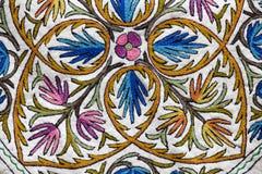 Kashmiri embroidered patterns on the carpet. Srinagar, India Stock Photo