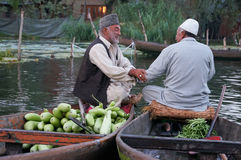 Kashmiri men sell their vegetables at a floating market in the e Stock Photo