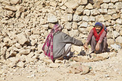 Kashmiri rock carriers taking chat break Stock Images