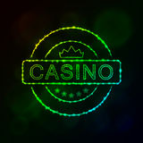 Kasinoemblemschattenbild von Lichtern Stockbild