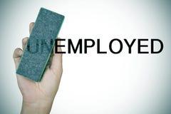 Kasować prefiks UN w słowa bezrobotni z gumką zdjęcia stock