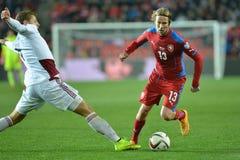 Kaspars Dubra and Jaroslav Plasil. Prague 28/03/2015 _ Match of EURO 2016 qualification group A Czech Republic - Latvia 1:1 (0:1). Goals 90' Pilař - 30' Viš Stock Image