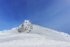 Kasprowy Wierch峰顶在Tatra山扎科帕内在冬天 免版税库存照片