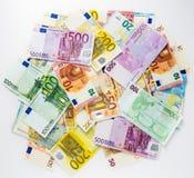 Kassa för begrepp för finans för eurosedelpengar på vit bakgrund Fotografering för Bildbyråer