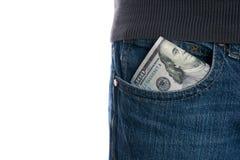 Kassa pengar är i facket av jeans Arkivbilder