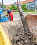 Kassel, Germany, May 22., 2017: Drilling work for the construction of a well to check the groundwater, removal of the drilling. Material from a drill auger royalty free stock photos