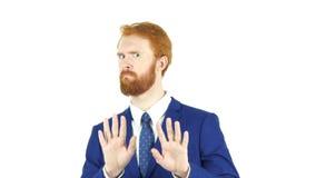 Kassera och att ogilla gest av den röda hårskäggaffärsmannen som isoleras arkivfoton