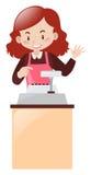 Kassierer, der hinter dem Schreibtisch arbeitet Lizenzfreies Stockfoto