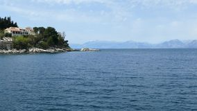 Kassiopi,科孚岛海岛,希腊村庄  爱奥尼亚海和房子岩石海岸小山的 影视素材