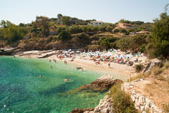 Kassiopi Beach, Corfu Island, Greece. Sunbeds and parasols (sun royalty free stock photo