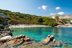 Kassiopi Beach, Corfu Island, Greece. Sunbeds and parasols (sun Stock Image