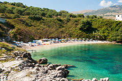 Kassiopi Beach, Corfu Island, Greece. Sunbeds and parasols (sun stock images